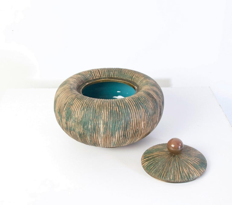 A beautiful pumpkin shaped bowl with lid crowned by a brass handle by Ceramiche Batignani from the 1950's. This handmade bowl is in perfect condition.