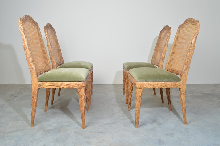 Set of four Louis XVI style faux noise branch form dining chairs having root carved frames and new moss tone velvet upholstery. Outstanding vintage condition with new cushioning and velvet upholstery, circa 1960.