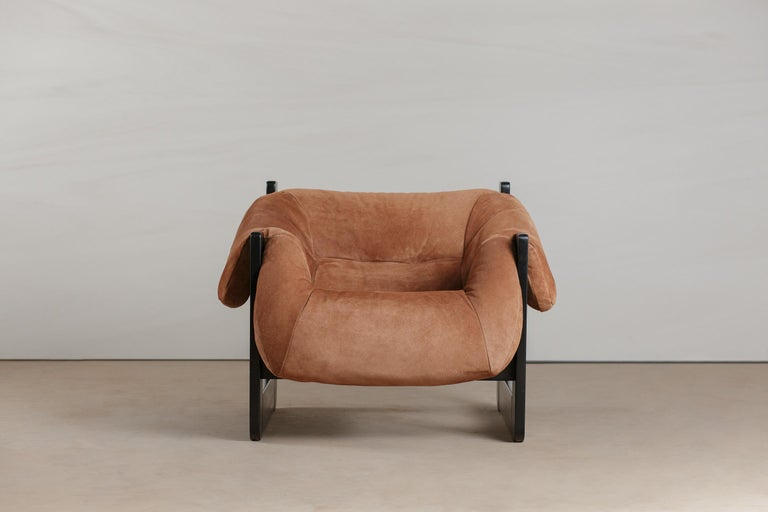 Pair of Mid-Century Modern lounge chair by Percival Lafer in ebonized and new upholstery. Really unique design and construction make this a true statement piece. The pair is sealed by
