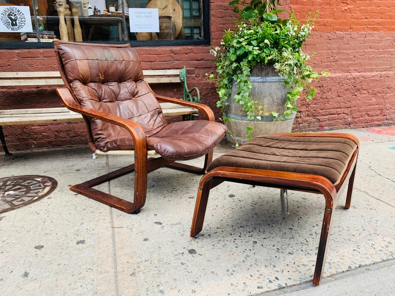 A beautifully lived in midcentury lounge armchair with a perfectly paired velvet ottoman.  Ottoman's Dimensions: 15