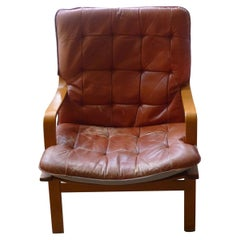 Midcentury Lounge Slingback Chair of Wood with Caramel Leather Cushion