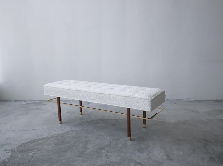 Absolutely stunning brass and mahogany bench by Harvey Probber. A solidly constructed piece with steel rods inside the legs for added stability and durability, not only is the bench beautiful it is functional.  Bench has been professionally