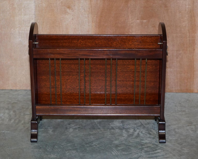 We are delighted to offer this lovely circa 1950-1960 Bevan Funnell mahogany magazine newspaper rack with Lion's head handles  A good looking, decorative and well made piece. The hands depict Lion's mains which are very decorative, the middle