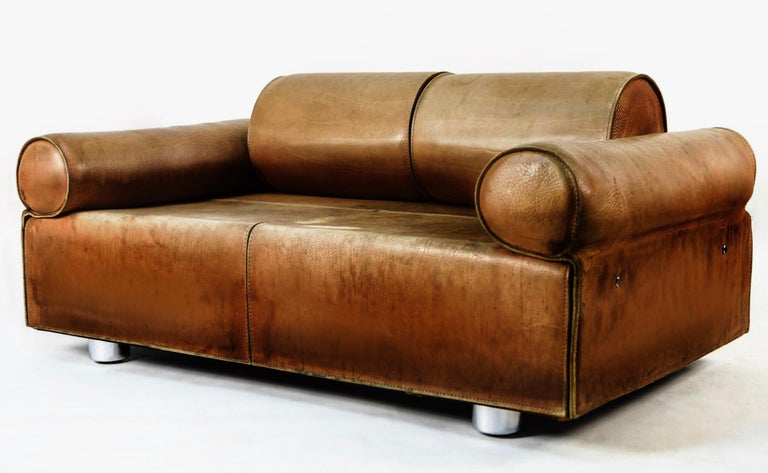 Rare buffalo two-seat sofa / daybed with Independently  adjustable back and arm rests / bolsters. Gorgeous patinated buffalo leather. Original hardware and legs.  by Iconic mid-century Italian designer Marzio Cecchi.   Exceptionally rare piece,