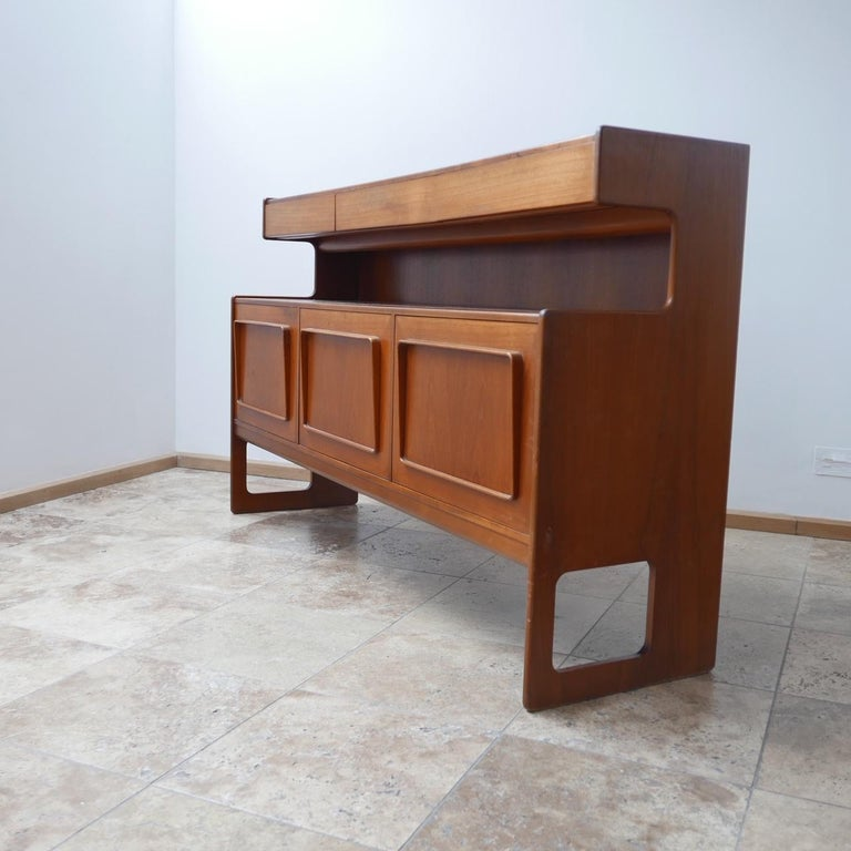 A rare sideboard by McInstosh.   Late 1960s-1970s.   Scottish, UK.   Three drawers top tier over three lower cabinets.   Highly functional.   Perfect to put a tv over as an example with the drawers for remotes and the cabinets for boxes