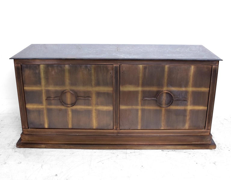 For your consideration a pair of bronze credenzas. Constructed with solid sheets of bronze and metal frame. Eglomized glass top with beveled edges.