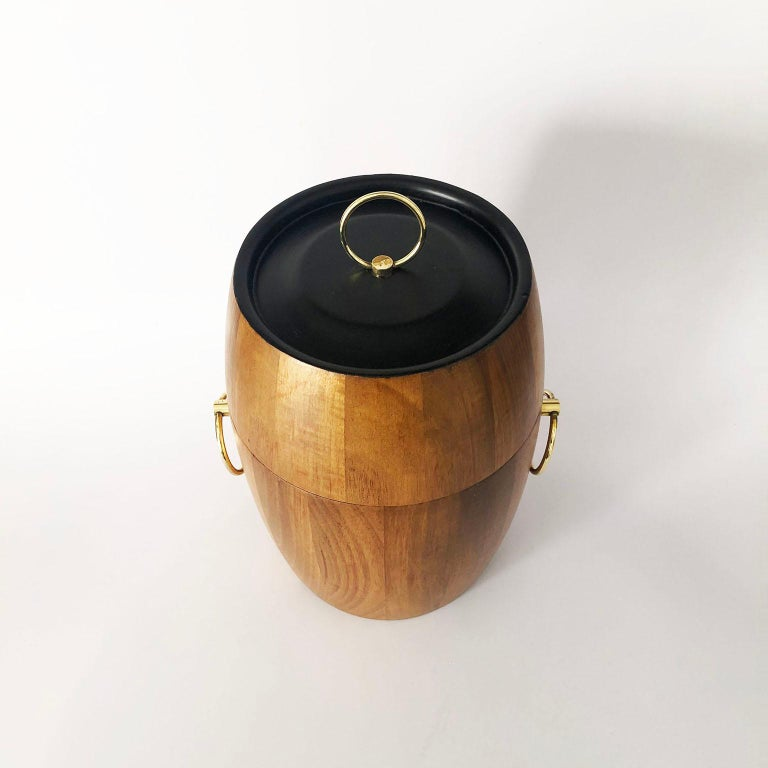 Circa 1950, we offer this mid-century Mexican modern ice bucket made in tropical woods. Recently restored.