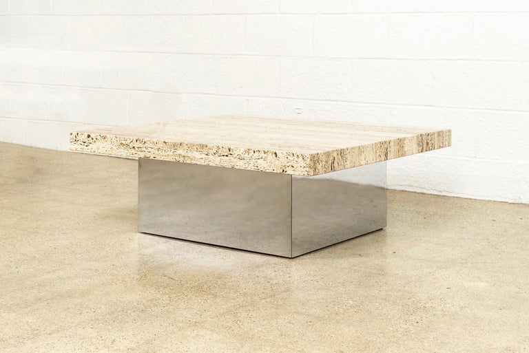 This Mid-Century Modern Milo Baughman (attribute) coffee table circa 1970 has a Classic Minimalist design with a low profile and clean geometric lines. This unique table features a thick, heavy stone tabletop accented with beautiful opaque