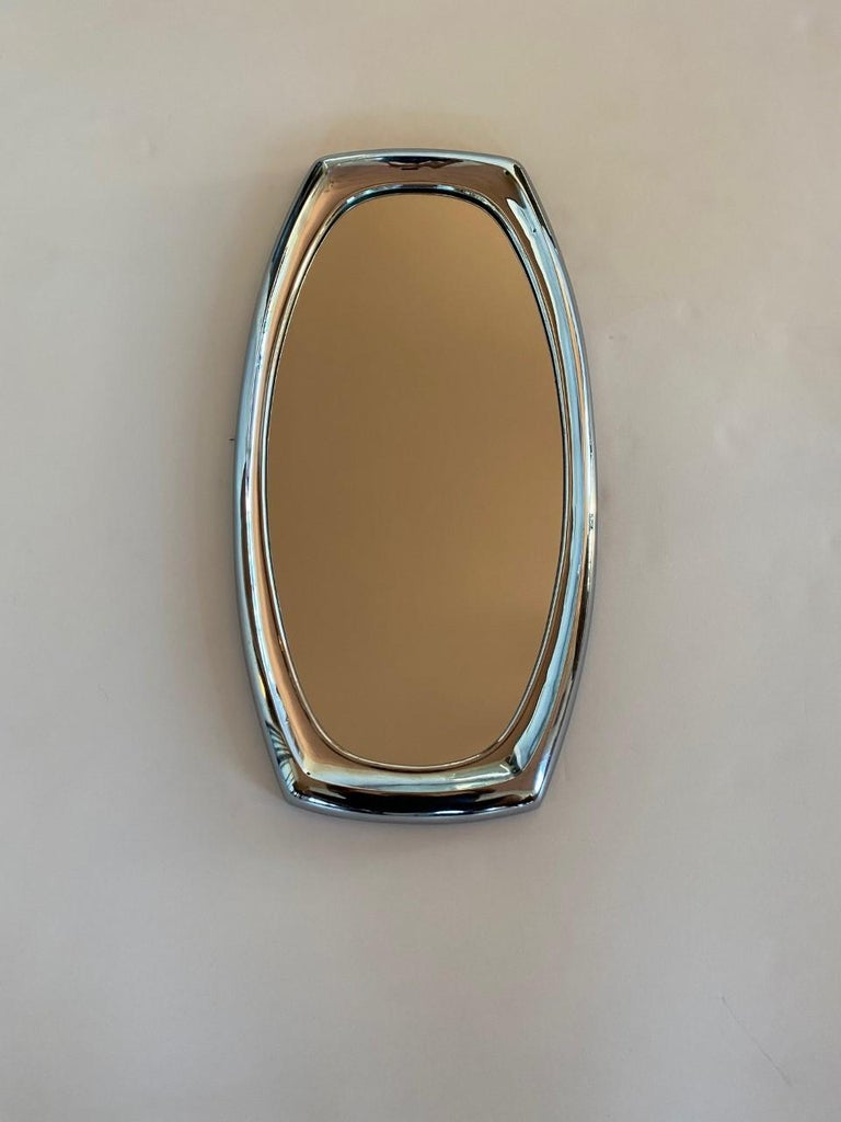 """Beautiful and Classic mirror by Syroco. Simple in shape with a midcentury feel. Vintage piece from 1966. 14"""" wide 26.5 Tall. Signed by Syroco 1966."""
