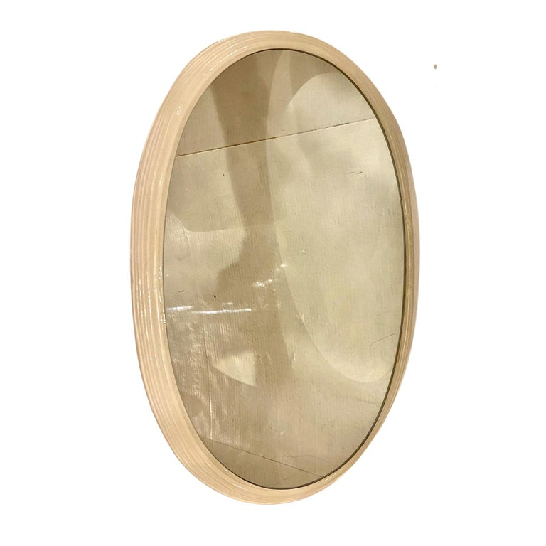 A circa 1960s Italian oval resin-framed mirror with backlight.  Measurements: Height 24.5