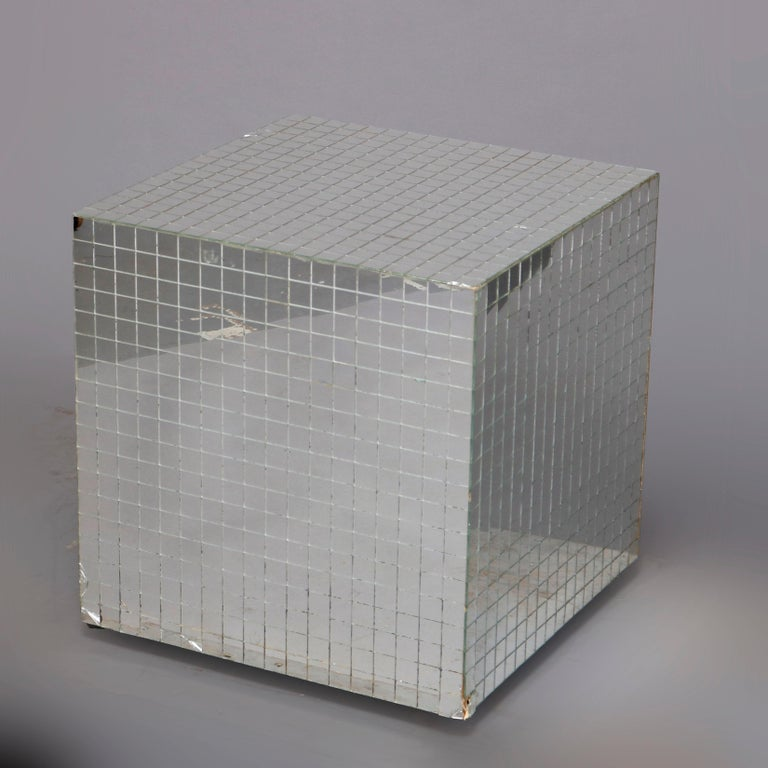 A Mid-Century Modern display end stand offers cube form with mirrored top and sides, 20th century  Measures: 18.75
