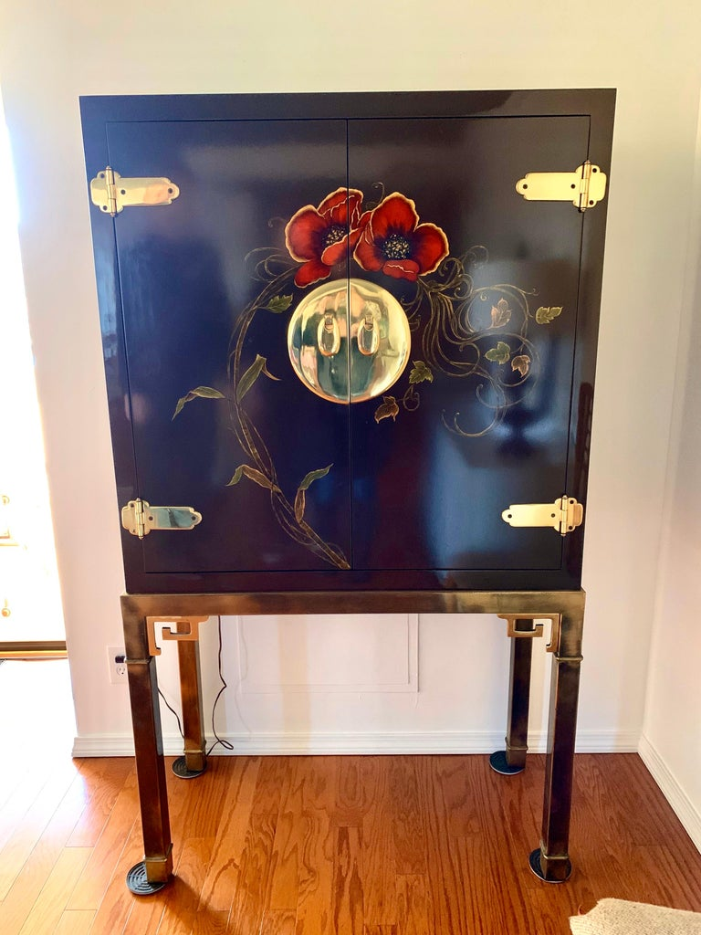 A coveted signed Mastercraft Classic, the mirrored bar cabinet which can also be used for entertainment system, etc. It has Greek key brass base and a lacquered top that looks like a work of art. What separates this piece from others is its