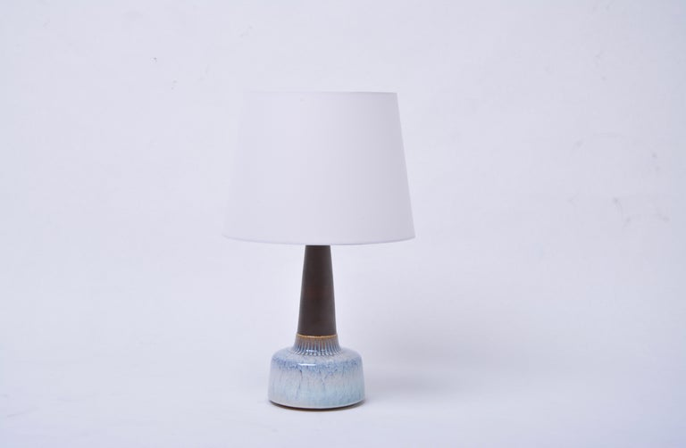 Pair of White Mid-Century Modern Ceramic table Lamps Model 941 by Soholm  Table lamp made of stoneware with light blue ceramic glazing to the base of the lamp. Designed by Einar Johansen and produced by Danish company Soholm. The lamp has been