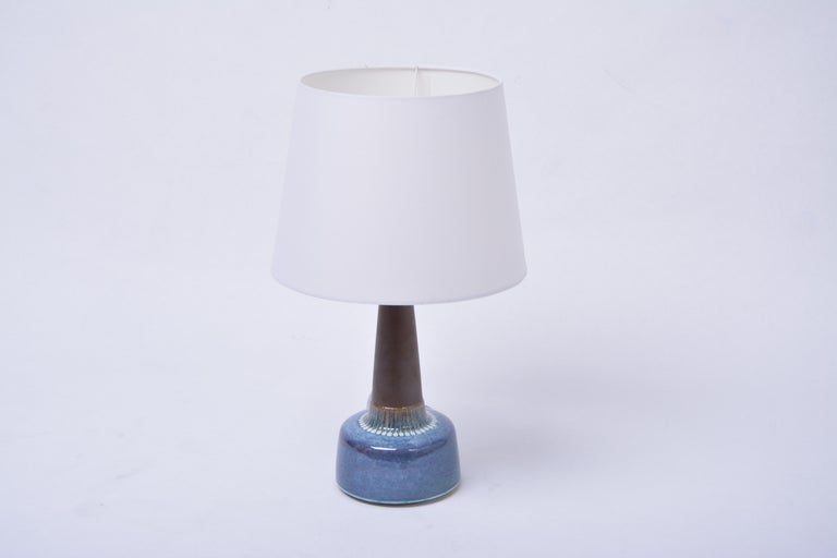 Mid-Century Modern model 1080  Stoneware table lamp by Einar Johansen for Søholm  Table lamp made of stoneware with light blue ceramic glazing to the base of the lamp. Designed by Einar Johansen and produced by Danish company Søholm. The lamp has
