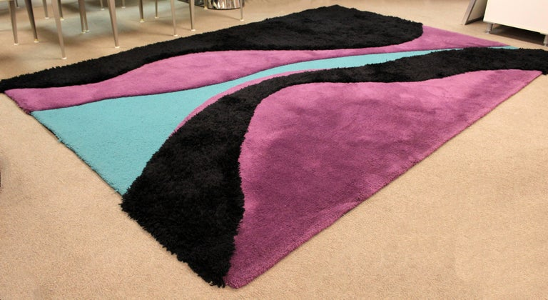 For your consideration is a fabulous area rug, made of 100% New Zealand wool colored black, teal and purple, by Carter Carpets, circa 1970s. In excellent condition. The dimensions are 110