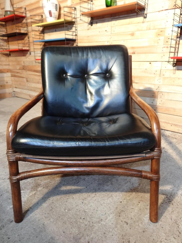 Dutch Mid-Century Modern 1960 Cane / Bamboo Designer Sling-Back Black Leather Chair For Sale