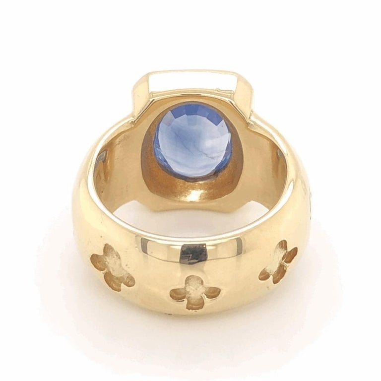 Beautiful, Elegant & finely detailed Fabulous '60s Gold Ring set with a 4.00 Carat oval shaped Blue Sapphire; complemented by Diamonds weighing approx. 0.32 total carat weight. The ring is Hand crafted in 18 Karat yellow Gold sensational dynamic