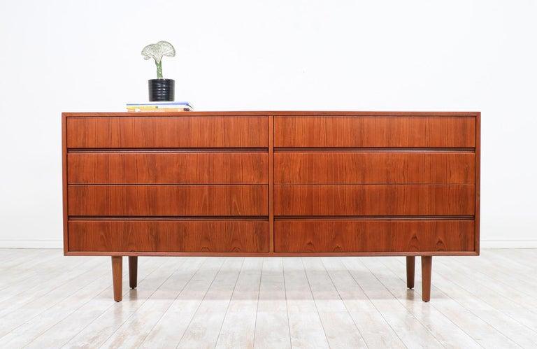 Mid-Century Modern 8-drawer teak dresser.