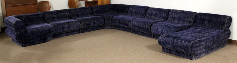 For your consideration is an incredible, nine piece sectional modular sofa, blue velvet with white accents upholstery, by Preview. In very good condition. The dimensions of the two corner pieces are 38