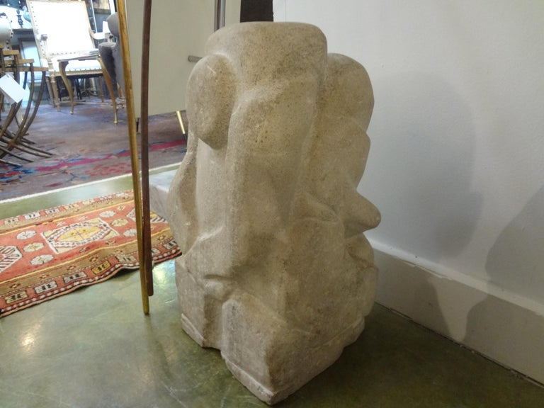 Well executed Mid-Century Modern granite abstract sculpture after Rene Brancusi. This fabulous stone sculpture has been carved on all sides and can be viewed and appreciated at every angle. Although unsigned, this modernist sculpture is clearly the