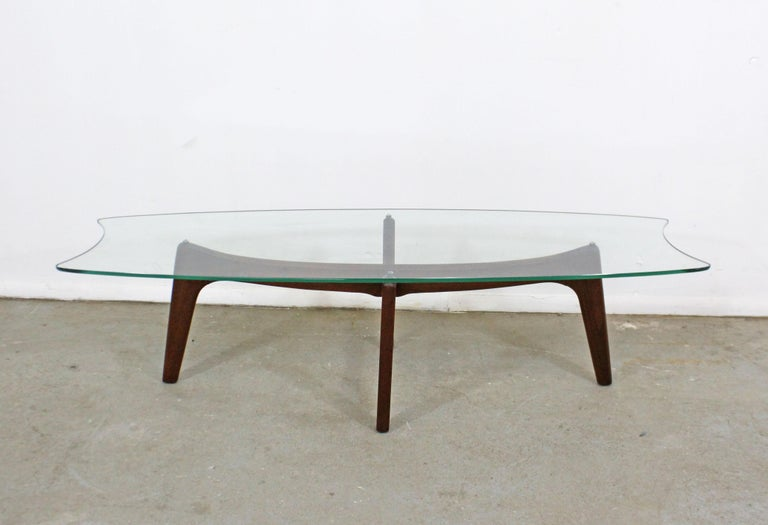 Offered is an authentic Adrian Pearsall 'Stingray' coffee table with a gorgeous sculptural wooden base and glass top. It was designed by Adrian Pearsall for Craft Associates. It is in good condition for its age, shows surface scratches on glass top