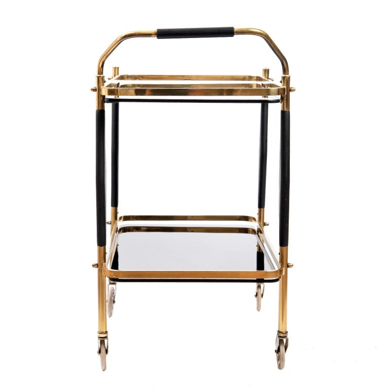 A little gem is how I would describe this vintage 1950s brass bar cart with original solid