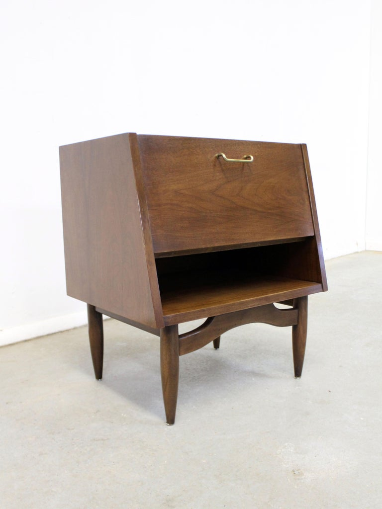 Offered is a walnut nightstand, designed by Merton L. Gershun for American of Martinsville's