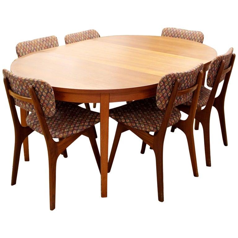 mid century modern arne hovmand olsen danish teak oval dining table and 6 chairs for sale at 1stdibs. Black Bedroom Furniture Sets. Home Design Ideas