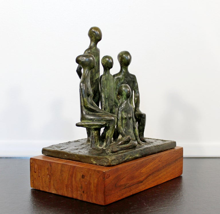 For your consideration is a wonderful sculpture of a family, made of bronze on a wood base, signed by Arthur Schneider, circa the 1970s. In excellent condition. The dimensions are 8.5