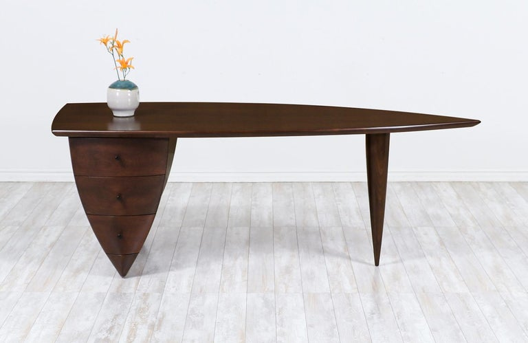 Mid-Century Modern asymmetrical executive desk after Wendell Castle.
