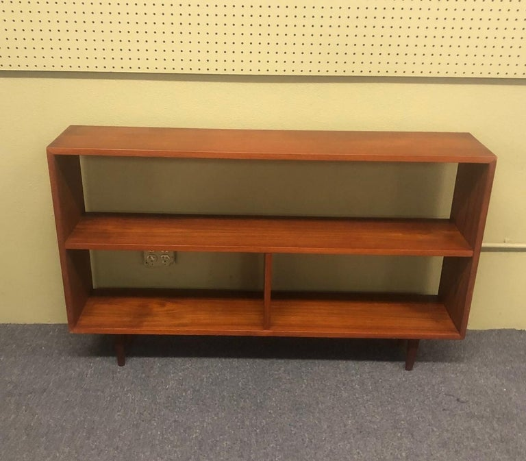 Canadian Mid-Century Modern Backless Low Profile Teak Bookcase with Tapered Legs For Sale