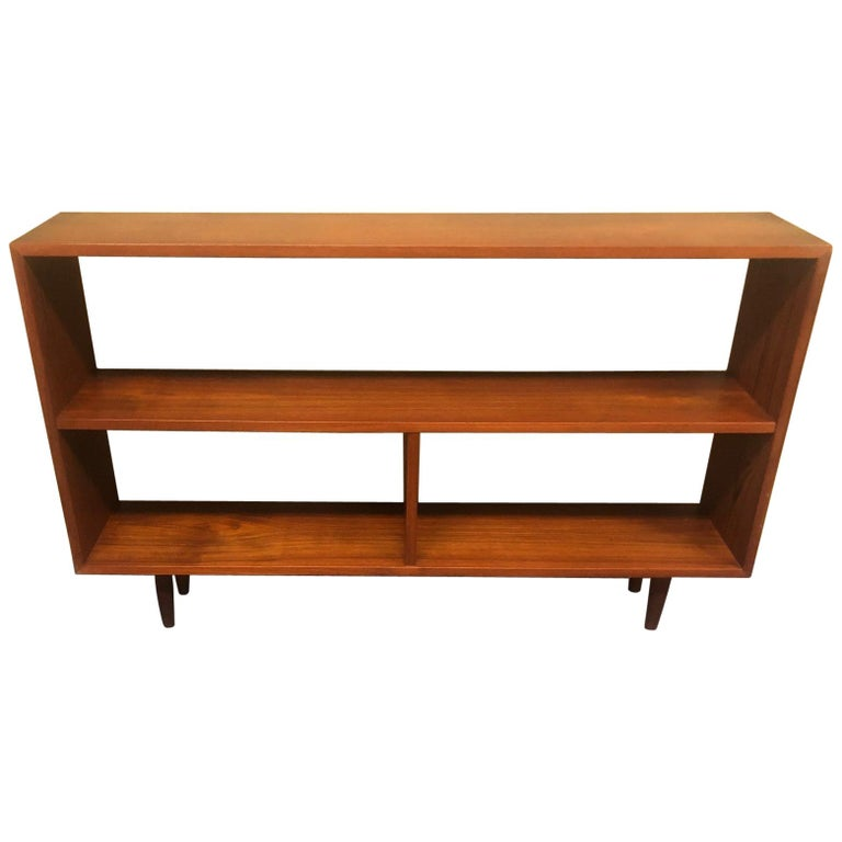 Mid-Century Modern Backless Low Profile Teak Bookcase with Tapered Legs For Sale