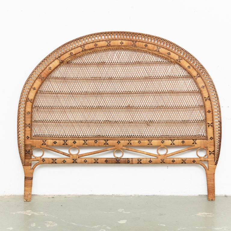 Mid-Century Modern bamboo and rattan headboard, circa 1960 Traditionally manufactured in France. By unknown designer.  In original condition with minor wear consistent of age and use, preserving a beautiful patina.