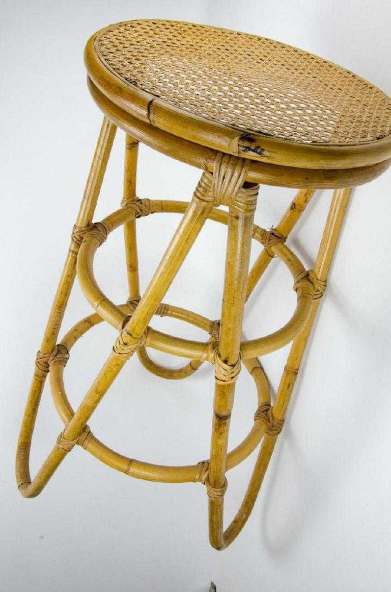 Pair of stylish deco style bamboo and caned vintage bar stools. Bent Bamboo frames and a caned seat.