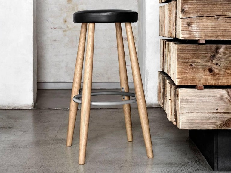Mid-Century Modern CH 56 stool by Hans Wegner. New edition. This elegant 76 cm barstool was designed by Hans J. Wegner in 1985. It is available in oak or walnut. Cushion is in Loke leather, easy to care. Comfortable and practical, upholstered bar