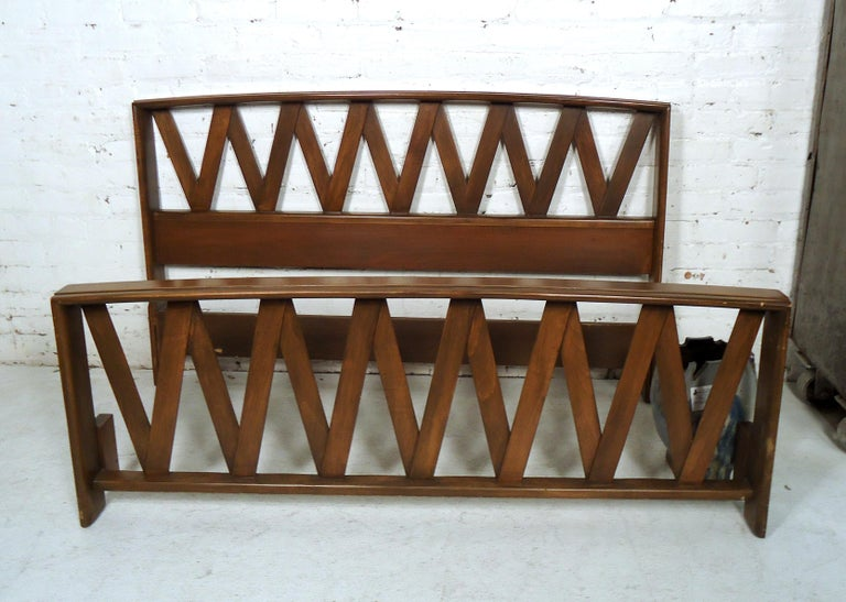 Gorgeous vintage modern bed frame by Paul Frankl features a dark finish, crisscross designed headboard and foot board.