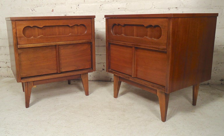 Pair of vintage nightstands with two drawers and decorative sculpted fronts. (Please confirm item location - NY or NJ - with dealer).