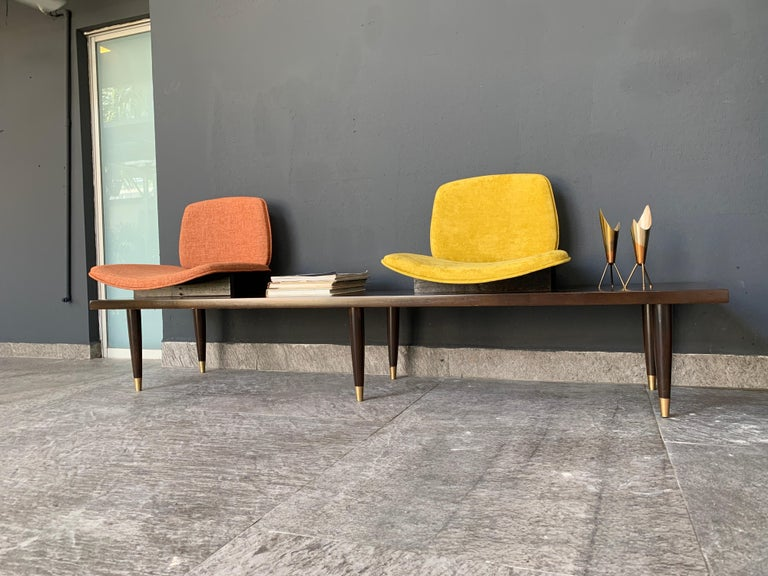 Modern bench 180 cms long, originally it had three seats but we decided to leave only two. The piece was in the waiting room of a renowned architectural firm.