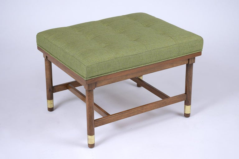 This Mid Century Modern Tufted Bench has been fully restored, made out of walnut wood and features a newly upholstered tufted cushion. This bench has its original dark walnut color stain with a newly lacquered finish, and the cushion has been