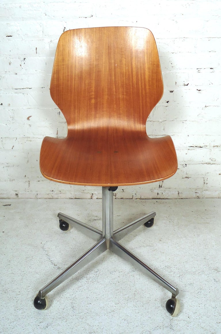 Sleek vintage modern bentwood rolling desk chair featured in rich teak wood grain made in Norway.  Please confirm item location (NY or NJ).