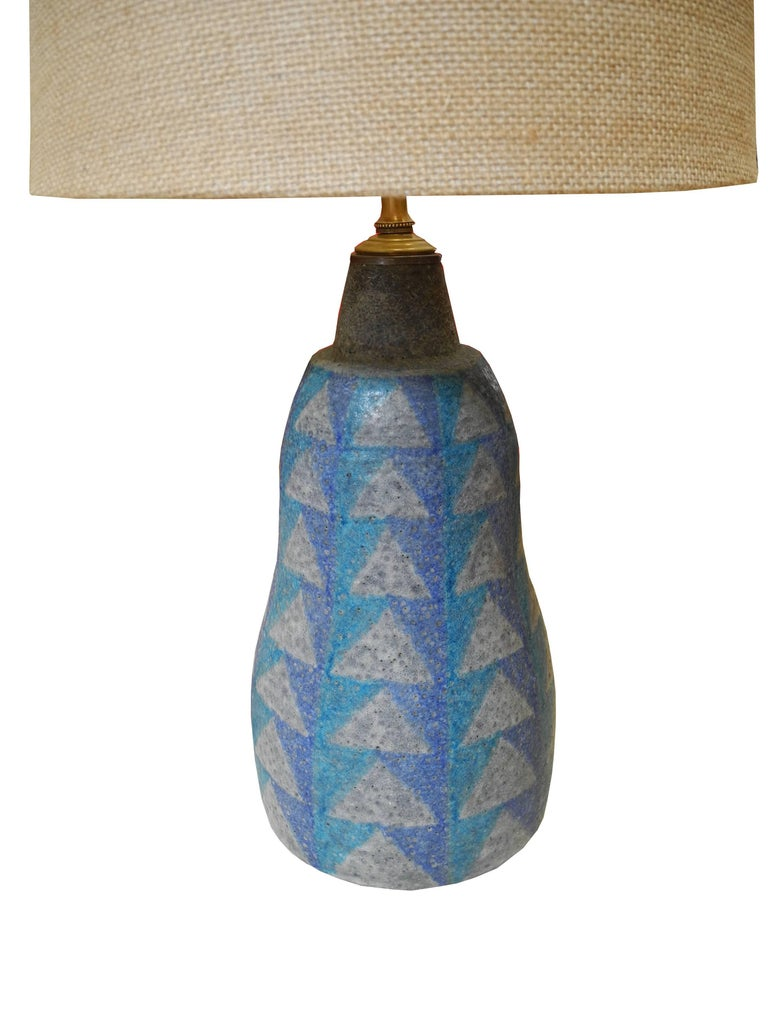 This lovely geometric design ceramic lamp with its lava like glaze was made in Italy.