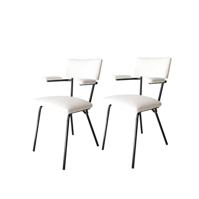 Pair of Italian manufactured chairs. Iron lacquered in black structure with white bouclé wool upholstery fabric.