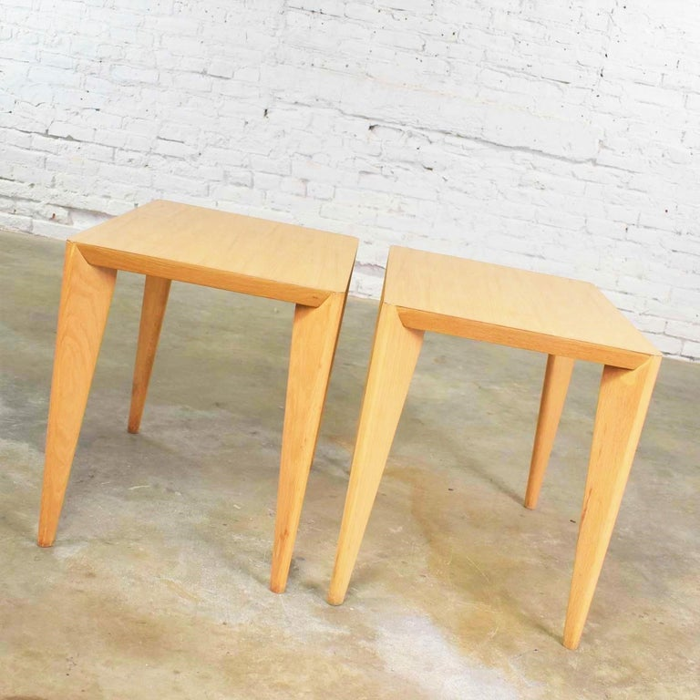 Handsome pair of blonde Mid-Century Modern side tables or end tables with light faux woodgrain laminate tops. They are wonderful restored condition although they may still have small signs of age and use. Please see photos, circa