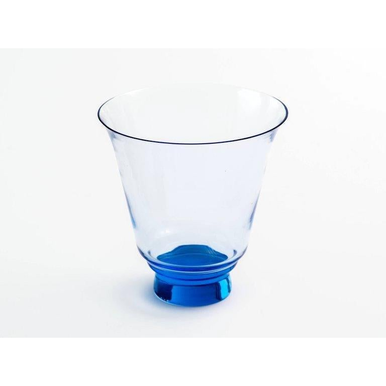 Mid-Century Modern hand blown glass vase with raised base. Alexandrite colored glass will change hues according to surrounding light. Vase has blue coloration with lilac undertones.