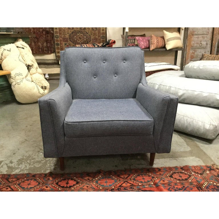 Awesome reupholstered midcentury armchair in light blue Denim. Could work in any space and has a cozy vibe.