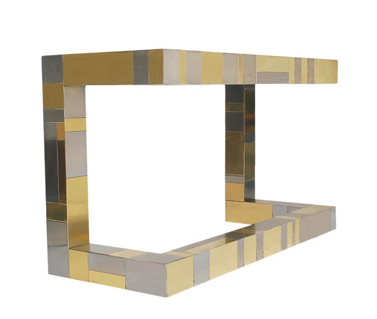 A stunning mixed metal patchwork design made by Paul Evans for Directional Furniture. This cantilevered design features brass and chrome panels and two drawers. Good overall condition, with minor scratching and small dimple dings.