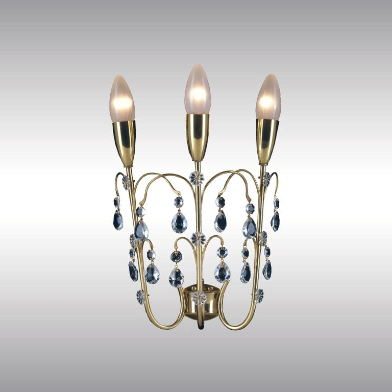 A delicate and fragile sconce.