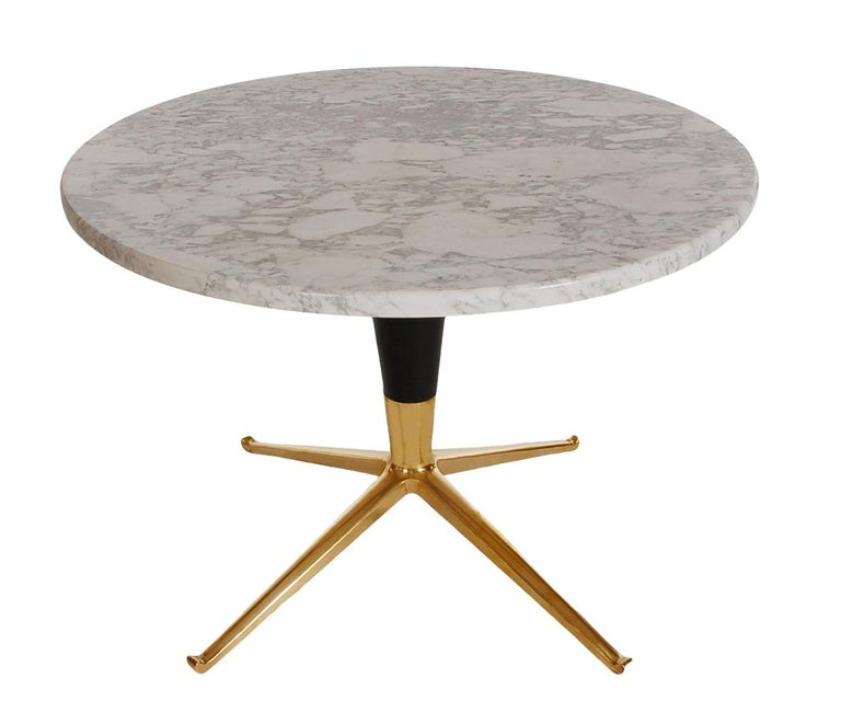 A chic circular side table from the 1950s in the style of Ico Parisi or Paul McCobb. The table features a brass pedestal base, black wood conical shaft, and thick round marble top. Nice, clean, and ready for immediate use.