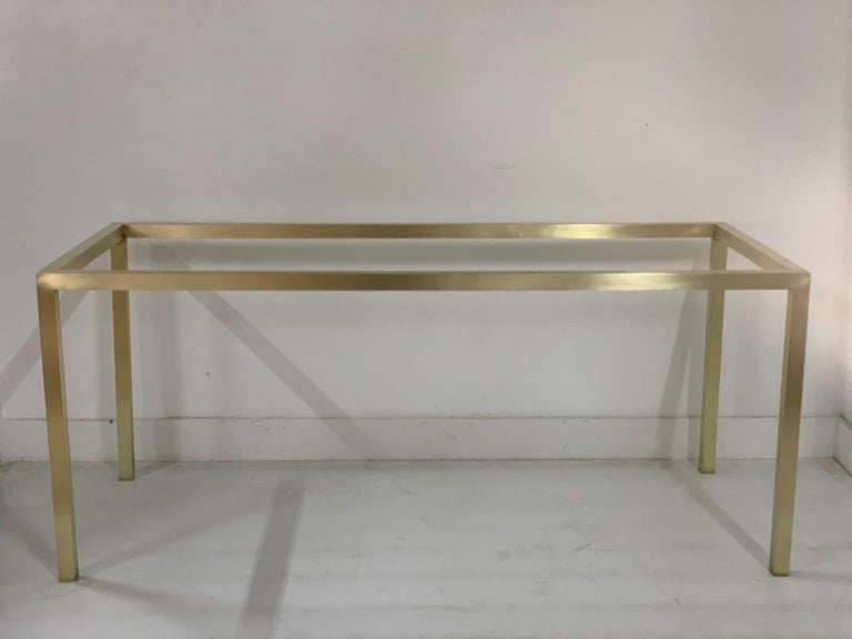Mid-Century Modern brass table base. The table base/frame is hollow brass. By adding your own glass or marble to the top, you'll have a special table.