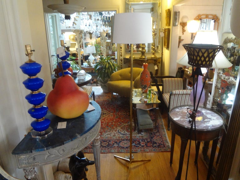 Beautiful Mid-Century Modern brass floor lamp in the manner of Paul McCobb. This modernist brass floor lamp has been newly wired with new fittings. The shade has minor wear and is best to replace.